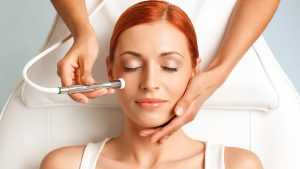 doctor performs radio frequency facial treatment